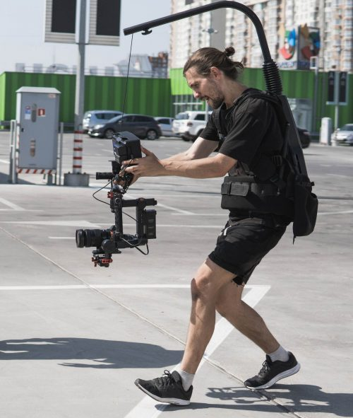 Image of our staff at Elite Video of Denver shoowing some footage out in a parking lot.